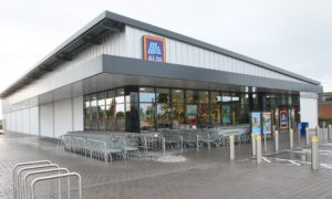 The outside of an Aldi supermarket on an overcast, grey day