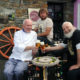 Members of Mescan Brewery sitting with chef Myles O'Brien at The Tavern restaurant, Murrisk