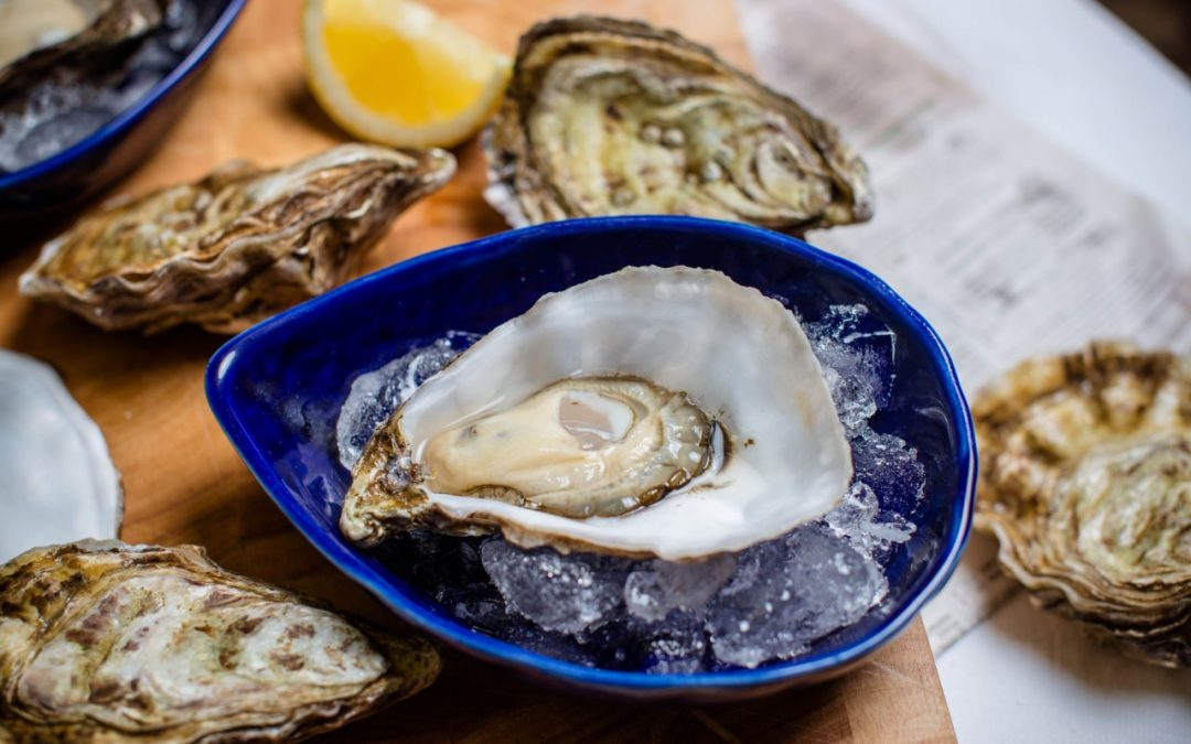 Achill Oyster in Achill Pottery bowl with lemon and unshucked oysters